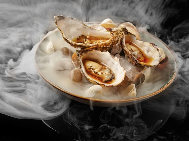 Upscale fine dinning oysters plate in a minimal modern style